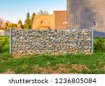 stone gabion wall or fence in... | Shutterstock . vector #1236805084