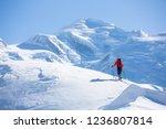 a skier in bright jacket is... | Shutterstock . vector #1236807814