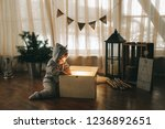 boy  christmas atmosphere at... | Shutterstock . vector #1236892651