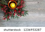 christmas candle with evergreen ... | Shutterstock . vector #1236953287