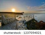 sunrise on a pier over atlantic ... | Shutterstock . vector #1237054021