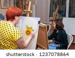 Small photo of Russia, Surgut, October 17, 2018: Art Studio for adults named after V.Gorda. Adult women students sit at easels, studying painting.