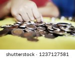 counting coins children are... | Shutterstock . vector #1237127581