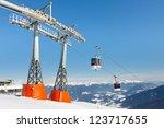 Gondolas reaching the summit station of alpine ski resort in South Tyrol. - stock photo