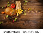 delicious hamburger with fries  ... | Shutterstock . vector #1237193437