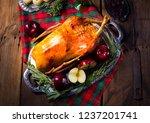festive stuffed roast goose... | Shutterstock . vector #1237201741