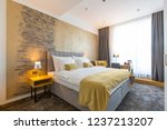 Stock photo interior of a luxury hotel bedroom 1237213207
