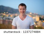 young happy tourist man smiling ... | Shutterstock . vector #1237274884