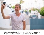 young handsome man smiling... | Shutterstock . vector #1237275844