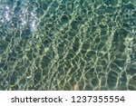 sun glare on the seabed | Shutterstock . vector #1237355554