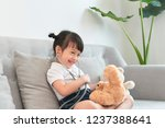 little asian girl play with... | Shutterstock . vector #1237388641