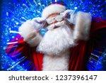 dj santa claus in snowy glasses ... | Shutterstock . vector #1237396147