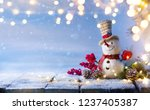 snowman and christmas tree... | Shutterstock . vector #1237405387