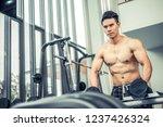 muscular man bodybuilder in... | Shutterstock . vector #1237426324