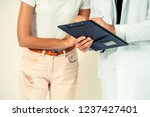 male doctor and female patient...   Shutterstock . vector #1237427401