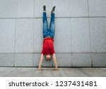 woman doing a handstand against ... | Shutterstock . vector #1237431481
