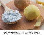 potato starch in a wooden spoon....   Shutterstock . vector #1237594981