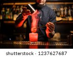 barman adding spices powder...   Shutterstock . vector #1237627687