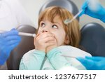 child refuses to show her teeth ... | Shutterstock . vector #1237677517