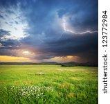 Meadow In Mountain. Rain Cloud...