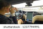 autonomous tesla car  march...   Shutterstock . vector #1237794991