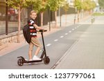school boy in riding with his... | Shutterstock . vector #1237797061