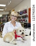 Stock photo portrait of senior woman with dog in pet shop 123790534