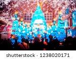 people in christmas lighting...   Shutterstock . vector #1238020171