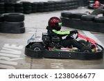 the man is going on the go kart ... | Shutterstock . vector #1238066677