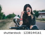 young woman on a motorcycle in... | Shutterstock . vector #1238144161