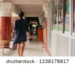 asian mother walking to the... | Shutterstock . vector #1238178817