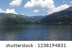 mountains reflecting in water.... | Shutterstock . vector #1238194831