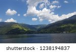 mountains reflecting in water.... | Shutterstock . vector #1238194837