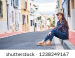 young smiling woman sitting on... | Shutterstock . vector #1238249167