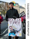 London, United Kingdom, November 17th 2018:-  A protester with an anti Tommy Robinson sign at the Stand Up To Racism march through central London from the BBC to near Downing Street in Whitehall - stock photo