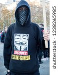 London, United Kingdom, November 17th 2018:- A masked activist at the Stand Up To Racism march through central London from the BBC to near Downing Street in Whitehall - stock photo