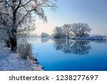 winter landscape reflecting in...   Shutterstock . vector #1238277697
