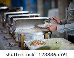 scooping the food  buffet food...   Shutterstock . vector #1238365591