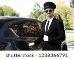 young handsome driver opening... | Shutterstock . vector #1238366791