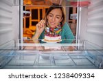 woman eating gateau while...   Shutterstock . vector #1238409334