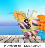 bag  sunglasses  on a... | Shutterstock . vector #1238468404