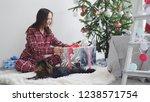 happy brunette girl opens gift...   Shutterstock . vector #1238571754