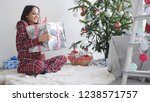 happy girl holds gift box by...   Shutterstock . vector #1238571757
