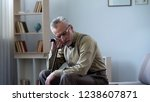smiling old man leaning on...   Shutterstock . vector #1238607871
