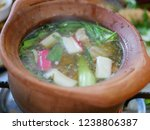 Small photo of Close up of appetizing Thai style hot pot ( Moo Joom ) in a clay pot
