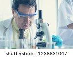 old man scientist using... | Shutterstock . vector #1238831047