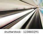 abstract picture of moving walkways with blurred people - stock photo