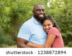 father hugging his daughter. | Shutterstock . vector #1238872894