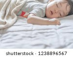 sleeping child concept. | Shutterstock . vector #1238896567