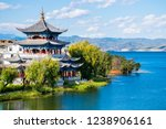 """The ancient wooden Buddhist Temple on the lakeside of Erhai lake in Dali town, Yunnan province, China. Translation is """"Buddha"""